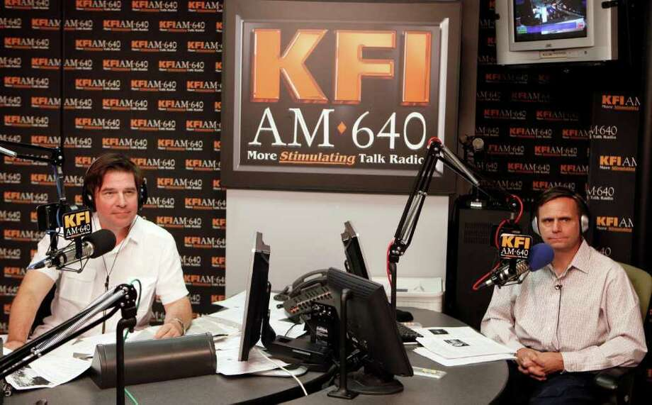 """In this March 9, 2011 file photo, KFI AM 640 Radio's John Kobylt, left, and Ken Chiampou, record their radio show at their station in Burbank, Calif. The station said in a statement that Kobylt and Chiampou were """"suspended for making insensitive and inappropriate comments about the late Whitney Houston."""" Kobylt said in statement that they """"used language that was inappropriate"""" and they """"sincerely apologize to our listeners and to the family of Ms. Houston."""" The hosts, who often rail against taxes and illegal immigration, will return to the airwaves Feb. 27.  (AP Photo/Damian Dovarganes) Photo: Damian Dovarganes"""