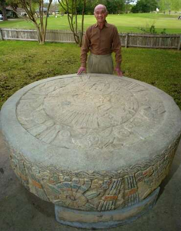 Roger Diaz stands by the huge Aztec calendar stone that found a home in his back yard on March 26, 2006. The curiosity once was a centerpiece in the lobby at the old Aztec Theatre in downtown San Antonio which has been recently restored. Photo: JOHN DAVENPORT, Express-News File Photo  / © San Antonio Express-News