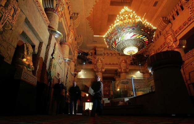 Construction workers move through the Grand Lobby of the Aztec Theatre on Thursday, March 24, 2006. Photo: BAHRAM MARK SOBHANI, Express-News File Photo  / SAN ANTONIO EXPRESS NEWS