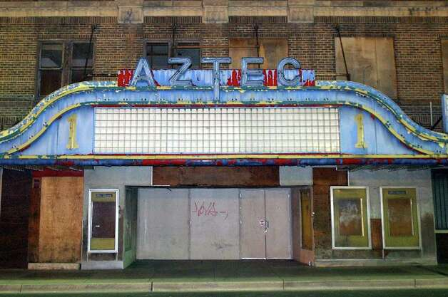 The facade of the Aztec Theatre, seen on April 28, 2004, will soon come back to life if renovation plans go as expected. Photo: BILLY CALZADA, Express-News File Photo