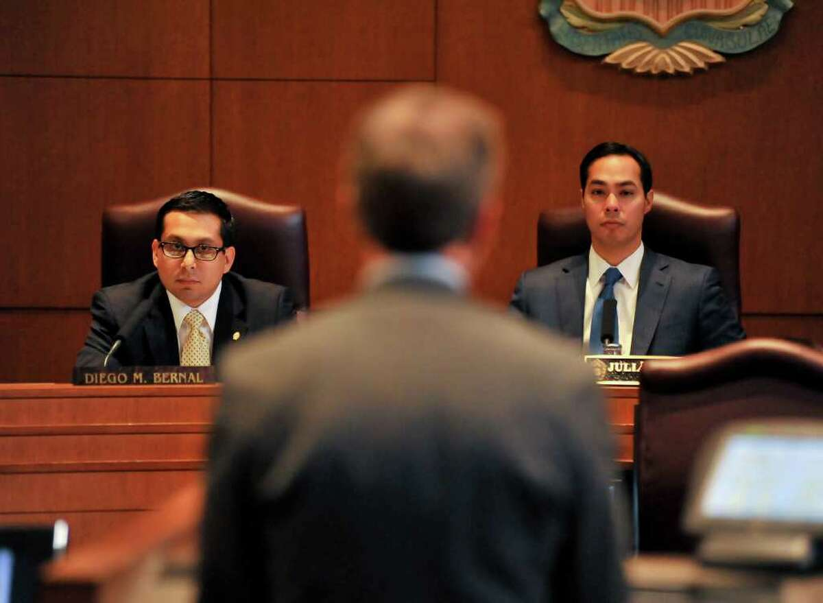 City Councilman Diego Bernal and Mayor Julián Castro listen to a speaker during discussion of the rezoning proposal for the property where Wal-Mart hopes to build a supercenter.