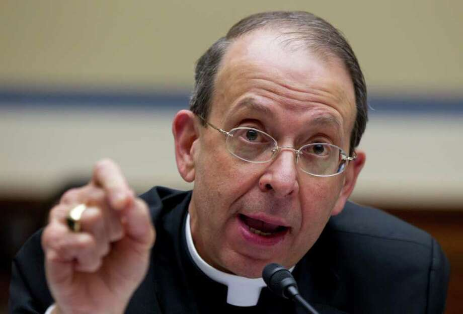 "Reverend William E. Lori, Roman Catholic Bishop of Bridgeport, Conn., speaks during a Oversight and Government Reform committee hearing on Capitol Hill in Washington, Thursday, Feb. 16, 2012, on ""Lines Crossed: Separation of Church and State. Has the Obama Administration Trampled on Freedom of Religion & Freedom of Conscience."" (AP Photo/Carolyn Kaster) Photo: Carolyn Kaster, Associated Press / AP"