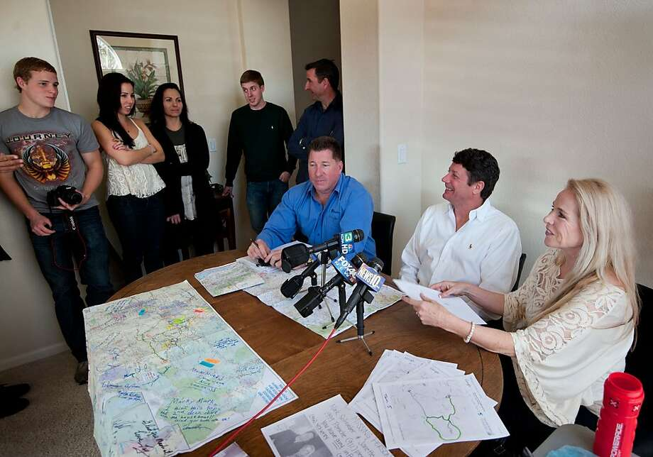 Mark Schroeder, center, and his girlfriend Janette DeGrace discuss their ordeal of three days stuck in the mountains, Thursday, Feb. 16, 2012 in Sacremento, Calif.. Jim Jungsten, left, in blue shirt, who is a close friend of Schroeder's helped organize the search. Schroeder and DeGrace's children stand a left. (AP Photo/The Sacramento Bee, Randy Pench) Photo: Randy Pench, Associated Press