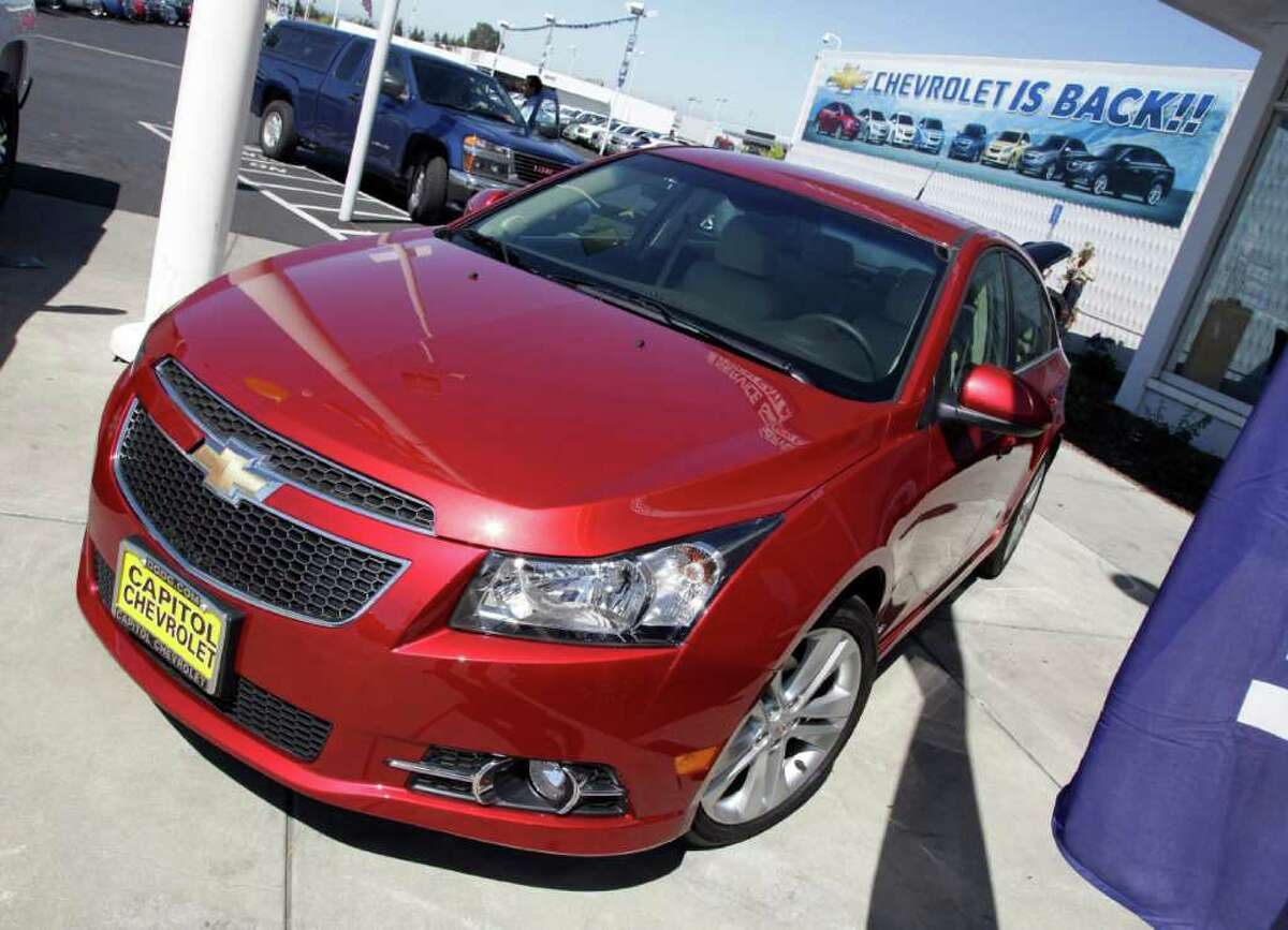 FILE - In this Aug. 30, 2011 file photo a 2011 Chevrolet Cruze is featured at a car dealership in San Jose, Calif. General Motors Co. said Thursday, Feb. 16, 2012, it made more money in 2011 than any year in its history. (AP Photo/Paul Sakuma)