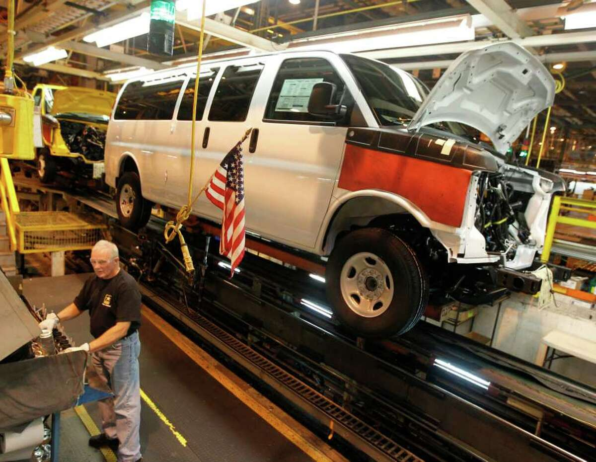 FILE - In this Nov. 3, 2011 file photo, a General Motors employee works on a van assembly line at GM's plant in Wentzville, Mo. General Motors Co. said Thursday, Feb. 16, 2012, it made more money in 2011 than any year in its history. (AP Photo/Jeff Roberson, File)
