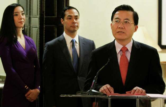 Zhu Kejiang, right, mayor of Wuxi, China, speaks during a Sister Cities signing ceremony as San Antonio mayor Julian Castro, center, listens with his wife, Erica, Thursday, Feb. 16, 2012, at the Henry B. Gonzalez Convention Center in San Antonio. Photo: Darren Abate / SAN ANTONIO EXPRESS-NEWS