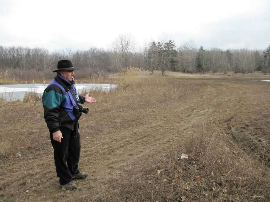 Gillian Scott/Times Union                              Schenectady City and County Historian Don Rittner discusses plans to restore dunes at the Woodlawn Pine Bush Preserve in Schenectady.
