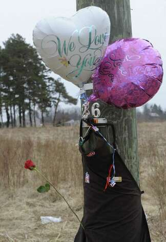 A makeshift memorial on a utility pole near Johnson Road in Halfmoon, N.Y. marks the scene of a fatal accident Feb. 16, 2012 which took the life of Travis Taylor, 18, of Mechanicville who was driving a 2002 Chevrolet Cavalier  at 9:18 p.m. last night when he lost control and the vehicle struck the telephone pole, police said.  ( Skip Dickstein / Times Union) Photo: Skip Dickstein / 2011