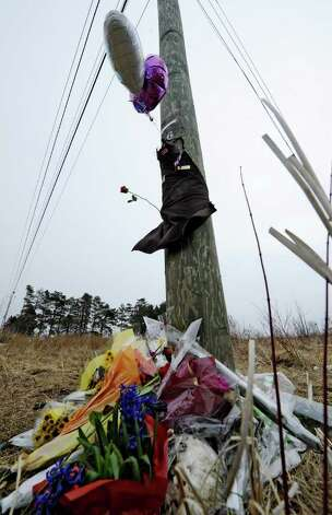 A makeshift memorial at the base of a utility pole near Johnson Road in Halfmoon, N.Y. marks the scene of a fatal accident Feb. 16, 2012 which took the life of Travis Taylor, 18, of Mechanicville who was driving a 2002 Chevrolet Cavalier  at 9:18 p.m. last night when he lost control and the vehicle struck the telephone pole, police said.  ( Skip Dickstein / Times Union) Photo: Skip Dickstein / 2011