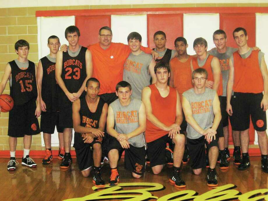 Jack Smith poses with the Orangefield basketball team. Smith's son Grey Smith died in a car accident in September. The Orangefield basketball team has dedicated its season to its former teammate, Grey. Photo: David Henry