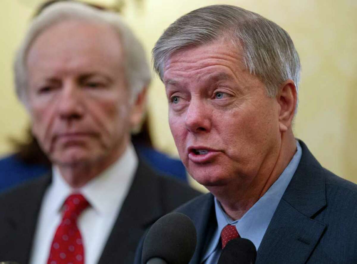 Sen. Lindsey Graham, R-S.C., right, accompanied by Sen. Joseph I. Lieberman, I-Conn., lead a bi-partisan group of senators in supporting President Obama's sanctions against Iran for pursuing nuclear weapons, Thursday, Feb. 16, 2012, during a news conference on Capitol Hill in Washington. (AP Photo/J. Scott Applewhite)