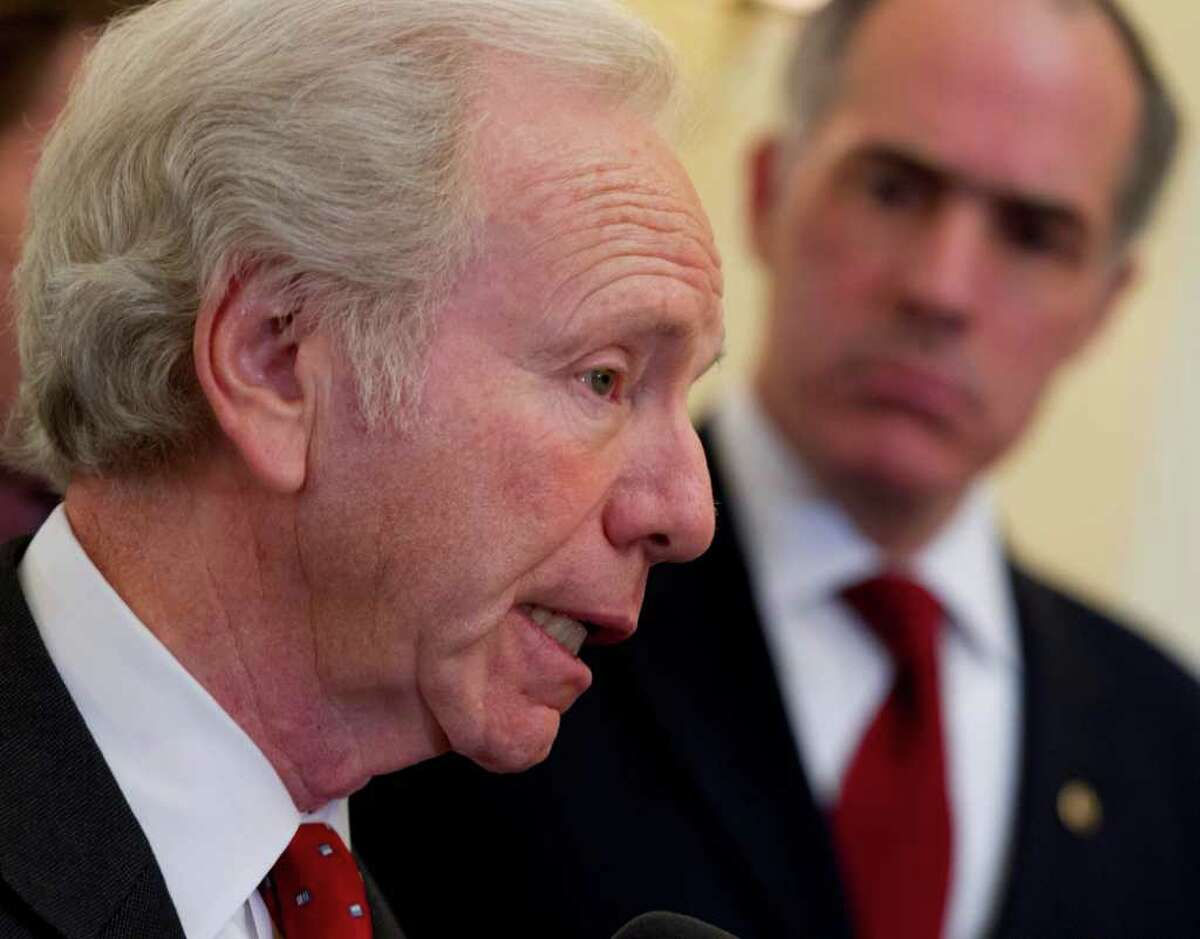 Sen. Joseph I. Lieberman, I-Conn., accompanied by Sen. Bob Casey, D-Pa., speaks during a bi-partisan news conference on Capitol Hill in Washington, Thursday, Feb. 16, 2012, to support President Obama's sanctions against Iran for pursuing nuclear weapons. (AP Photo/J. Scott Applewhite)