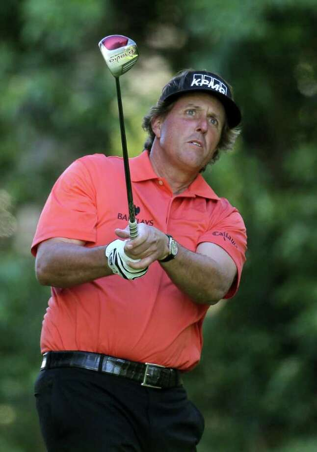 PACIFIC PALISADES, CA - FEBRUARY 16:  Phil Mickelson watches his tee shot on the 12th hole during the first round of the Northern Trust Open at Riviera Country Club on February 16, 2012 in Pacific Palisades, California.  (Photo by Stephen Dunn/Getty Images) Photo: Stephen Dunn