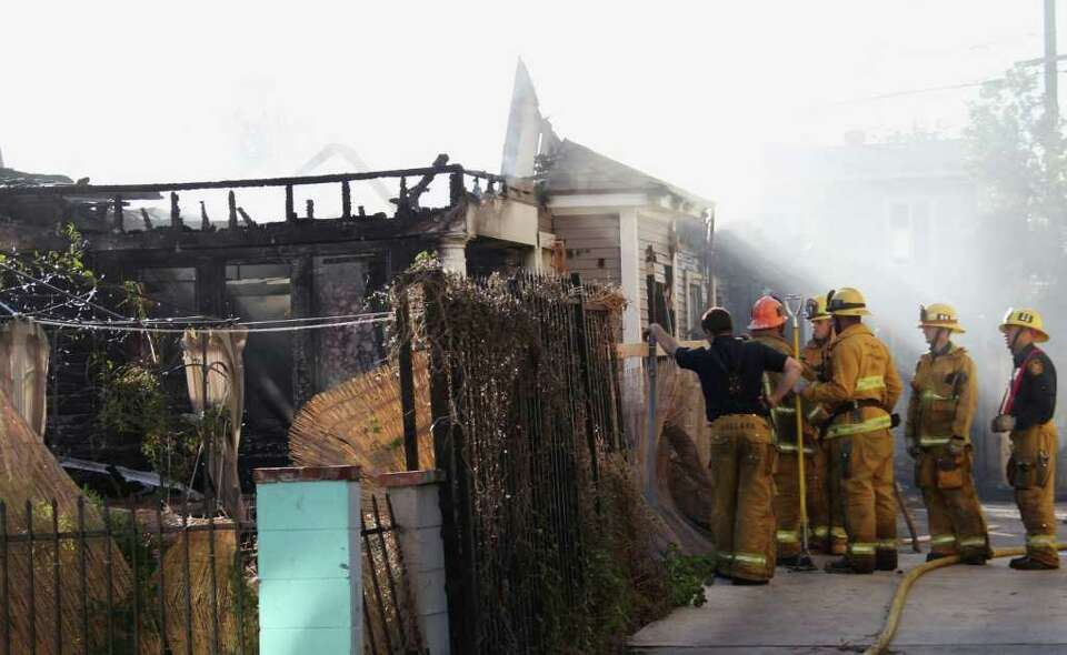 Los Angeles firefighters are shown at the scene of a fire and shooting Thursday Feb. 16, 2012 in Los