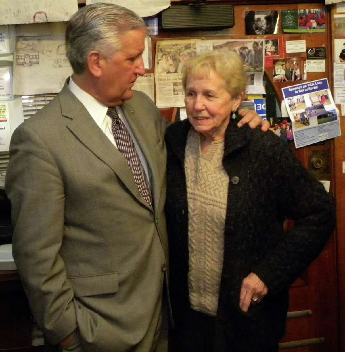 Albany Mayor Jerry Jennings chats with Jane Brown, who recently sold and closed the Miss Albany Diner after more than 23 years in business, during a send-off reception Thursday night, Feb. 16, at the diner. Brown, who is retiring, said she plans to write a cookbook with the diner's recipes. (Steve Barnes/Times Union)