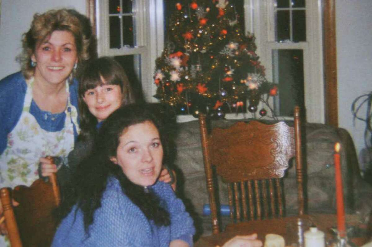 Peggy Dunn, 57, left, was killed in a car crash at age 57 on Feb. 12, a day after her daughter, Rachael Keeler, right age 40, died of liver disease. In between in this 2002 photo is Keeler's daughter, Kaiya, who will bury both her mother and grandmother on Friday. (Courtesy Stephen Keeler)