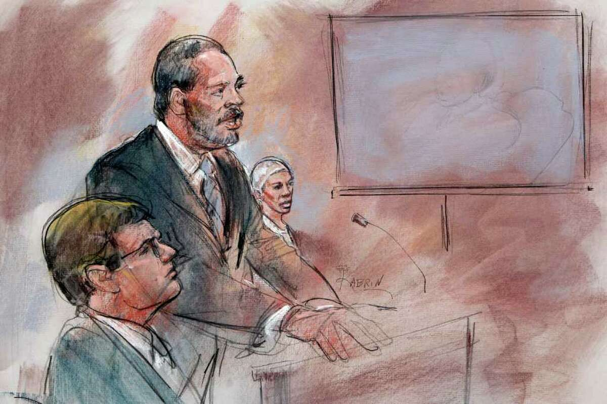 In a courtroom sketch, attorney Anthony Chambers, center, an attorney assigned to help Umar Farouk Abdulmutallab, right, the man who tried blowing up a Northwest Airlines flight on Christmas Day 2009, stands before U.S. District Judge Nancy Edmonds in federal court in Detroit, Thursday, Feb. 16, 2012. Abdulmutallab was sentenced to life in prison. (AP Photo/Carole Kabrin)