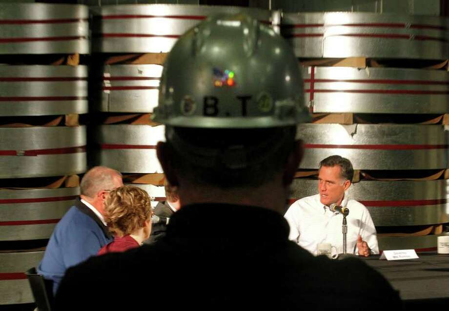 A worker in hardhat, and others, listen as Republican presidential candidate, former Massachusetts Gov. Mitt Romney speaks at an economic round table at National Galvanizing in Monroe, Mich., Thursday, Feb. 16, 2012. Photo: Gerald Herbert, Associated Press / AP