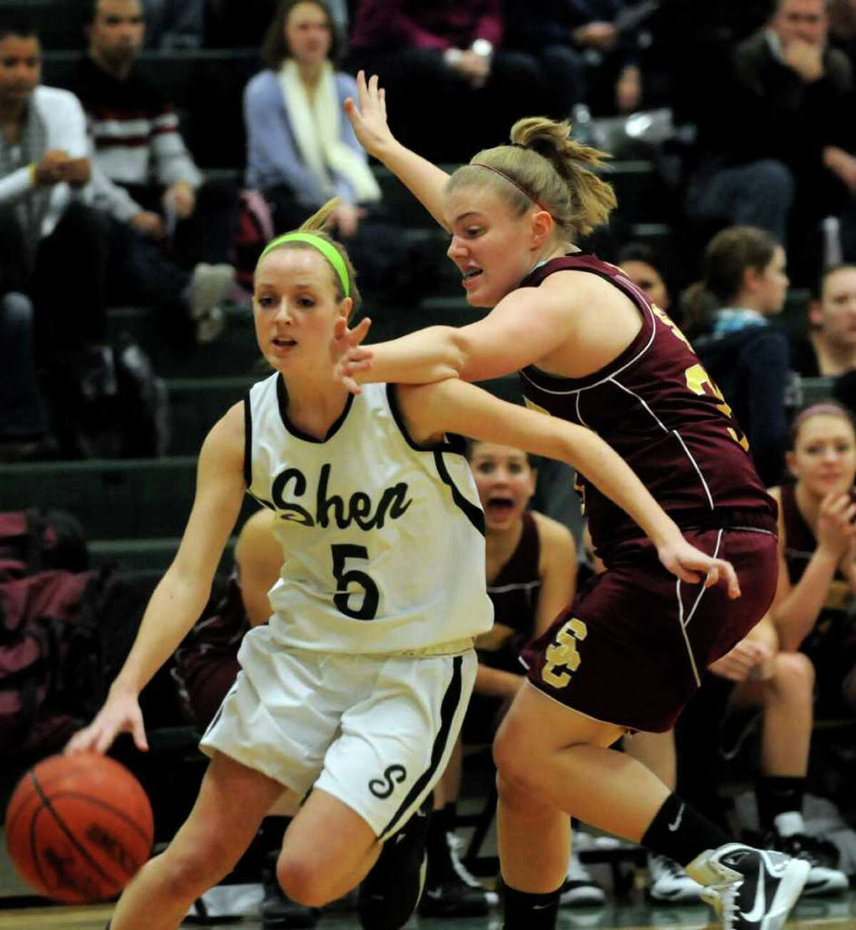 Shen's Mary Kate Cusack (5), right, drives to the hoop as Colonie's Kolbe Robinson (35), right, defends during their basketball game on Friday, Dec. 17, 2010, at Shenendehowa High in Clifton Park, N.Y. (Cindy Schultz / Times Union)