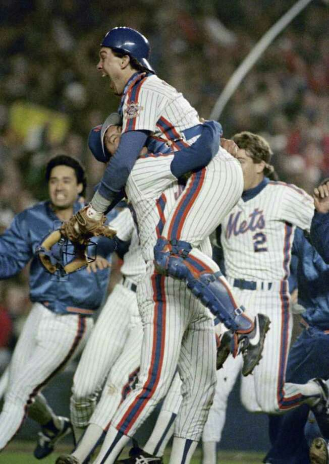 FILE - In this Oct. 27, 1986, file photo, New York Mets Gary Carter is lifted in the air by relief pitcher Jese Orosco following the Met 8-5 victory over the Boston Red Sox in Game 7 of baseballs World Series at New York's Shea Stadium. Baseball Hall of Fame president Jeff Idelson said Thursday, Feb. 16, 2012, that Hall of Fame catcher Gary Carter has died. (AP Photo/Paul Benoit, File) Photo: Paul Benoit