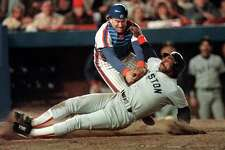 FILE - In this Oct. 25, 1986 file photo, Boston Red Sox's Jim Rice is tagged out at the plate by New York Mets catcher Gary Carter during seventh inning action in Game 6 of baseball's World Series at New York's Shea Stadium. Baseball Hall of Fame president Jeff Idelson said Thursday, Feb. 16, 2012, that Hall of Fame catcher Gary Carter has died. (AP Photo/Peter Southwick, File)