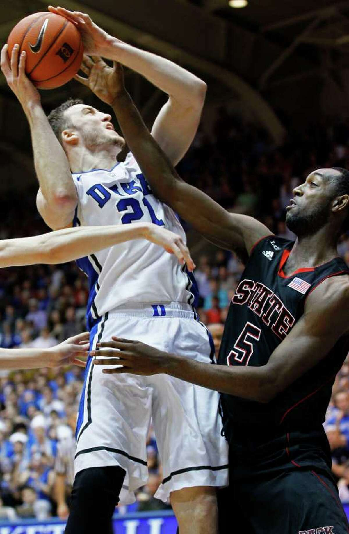 Duke's Miles Plumlee (21) is pressured by North Carolina State's C.J. Leslie (5)during the first half of an NCAA college basketball game in Durham, N.C., Thursday, Feb. 16, 2012. (AP Photo/Gerry Broome)