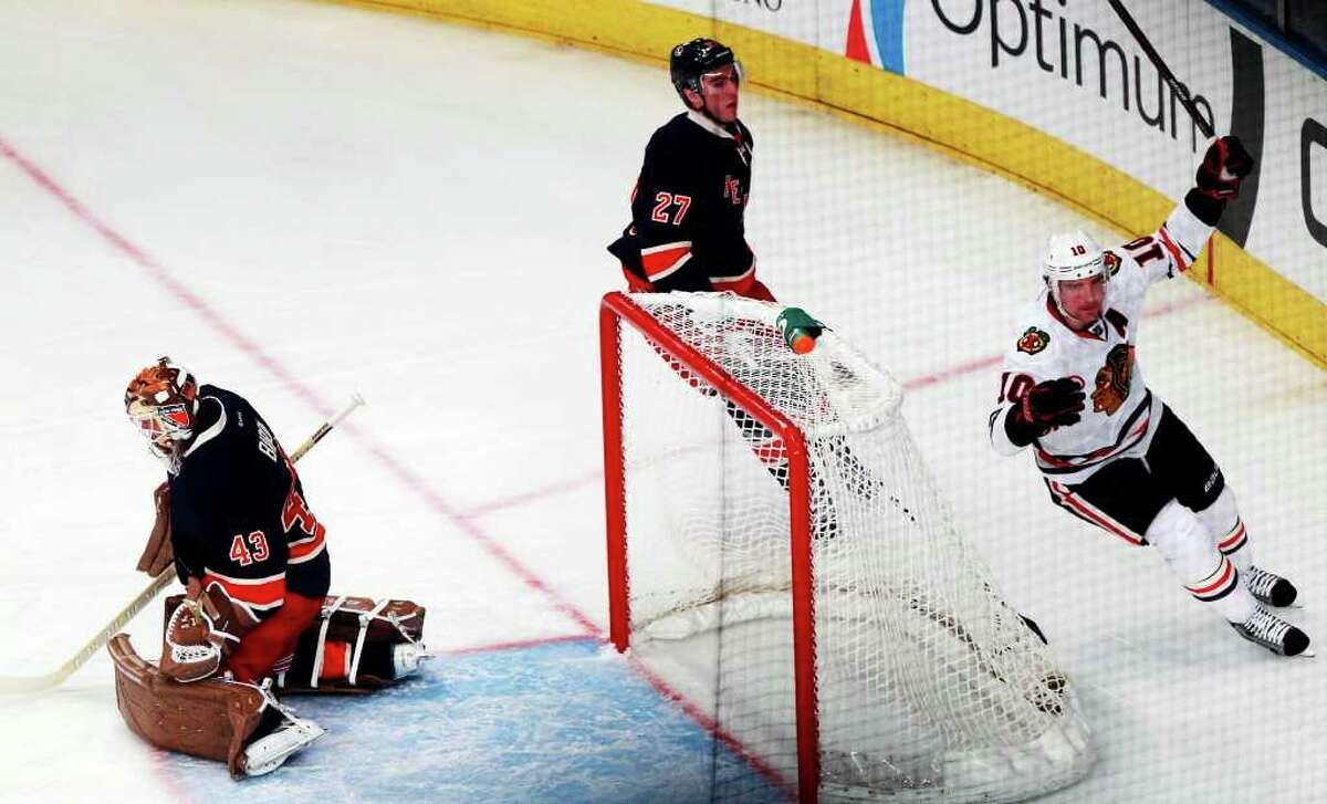 Chicago Blackhawks' Patrick Sharp (10) celebrates after scoring a goal on New York Rangers goalie Martin Biron (43) during the first period of an NHL hockey game Thursday, Feb. 16, 2012, in New York. (AP Photo/Frank Franklin II)