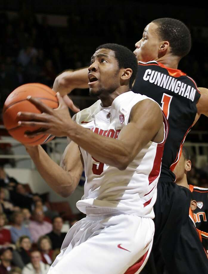 Stanford's Chasson Randle, who had 24 points, drives past Oregon State's Jared Cunningham. Photo: Paul Sakuma, Associated Press