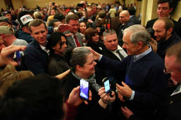 Ron Paul trails in the Republican presidential race, but has a fervent base in Washington.  He is camaigning here on caucus day. Photo: JOSHUA TRUJILLO / SEATTLEPI.COM