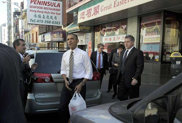 President Barack Obama gets Chinese food from Great Eastern Restaurant in San Francisco, Thursday, Feb. 16, 2012. Obama is on a three-day trip to the West Coast for fundraising. (AP Photo/Susan Walsh) Photo: Susan Walsh, Associated Press