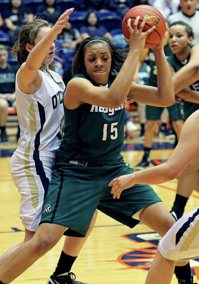 Reagan's Sabrina Berry posts up as the Rattler girls play O'Connor in playoff action at the UTSA Convocation Center on Thursday, Feb. 16, 2012. Photo: TOM REEL, San Antonio Express-News / San Antonio Express-News