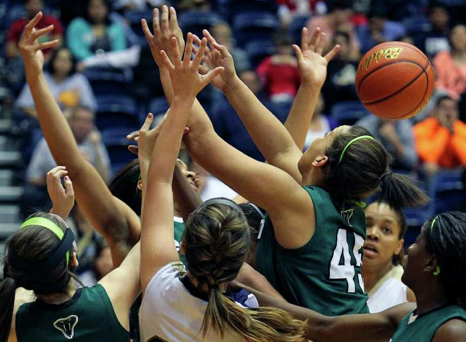 Nobody claims the ball in a tough battle under the boards as the Reagan girls play O'Connor in playoff action at the UTSA Convocation Center on Thursday, Feb. 16, 2012. Photo: TOM REEL, San Antonio Express-News / San Antonio Express-News