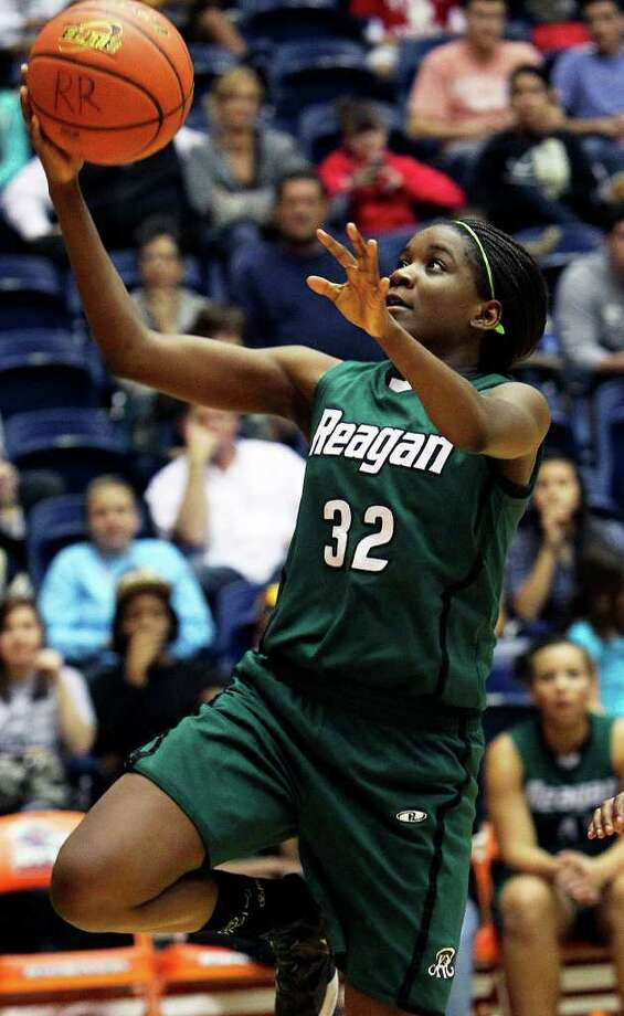 Reagan's Moriah Mack rolls in to score off of a steal as the Rattler girls play O'Connor in playoff action at the UTSA Convocation Center on Thursday, Feb. 16, 2012. Photo: TOM REEL, San Antonio Express-News / San Antonio Express-News