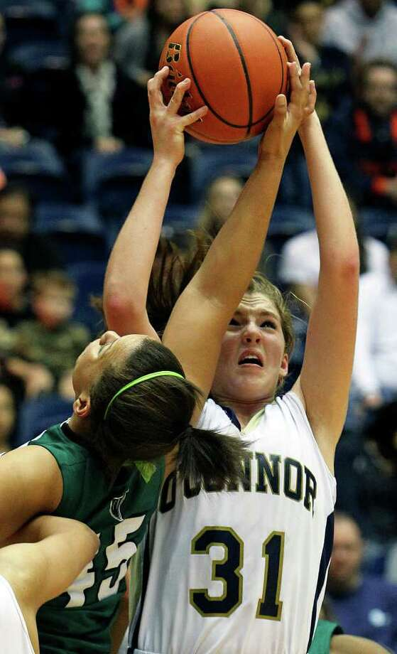 O'Connor's Shelbi Miller (31) gets in a rebound fight with Reagan's Corrigan Tibbs as the Rattler girls play the Panthers in playoff action at the UTSA Convocation Center on Thursday, Feb. 16, 2012. Photo: TOM REEL, San Antonio Express-News / San Antonio Express-News