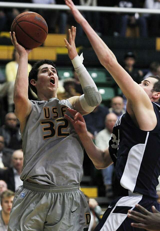 San Francisco's Angelo Caloiaro (32) shoots as BYU's Noah Hartsock defends during the second half of an NCAA college basketball game in San Francisco, Thursday, Feb. 16, 2012. BYU beat San Francisco 85-84. (AP Photo/George Nikitin) Photo: George Nikitin, Associated Press