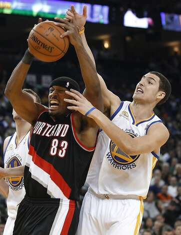 Portland Trail Blazers' Craig Smith (83) and Golden State Warriors' Klay Thompson (11) vie for a rebound during the first half of an NBA basketball game in Oakland, Calif., Wednesday, Feb. 15, 2012. Photo: Tony Avelar, Associated Press
