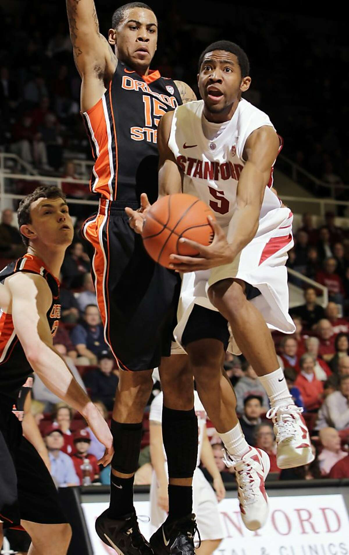 Stanford guard Chasson Randle (5) shoots to score in front of Oregon State forward Eric Moreland (15) during the first half of an NCAA college basketball game in Stanford, Calif., Thursday, Feb. 16, 2012.