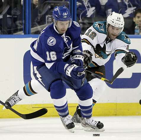 Tampa Bay Lightning right wing Teddy Purcell (16) keeps the puck from San Jose Sharks left wing Patrick Marleau (12) during the first period of an NHL hockey game Thursday, Feb. 16, 2012, in Tampa, Fla. Photo: Chris O'Meara, Associated Press