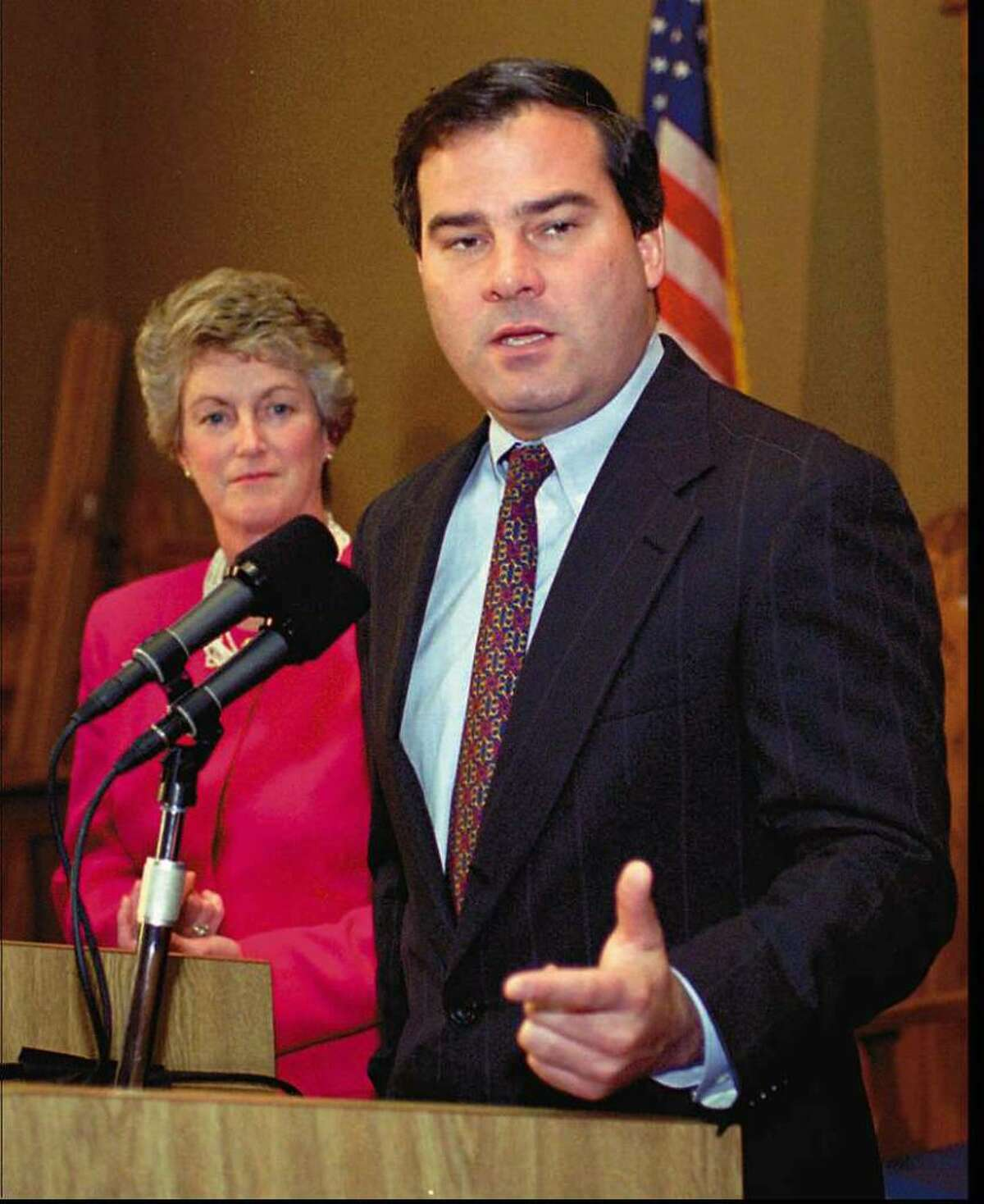 Then Governor-elect John G. Rowland speaks at a news conference at the state capitol in Hartford Wednesday, Nov. 9, 1994, the first day after he won the election. Rowland was 37 at the time. At left is then Lt. Gov.-elect state Rep. Jodi Rell, R-Brookfield. (AP Photo/Bob Child)