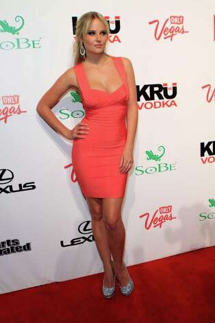 SI swimsuit model Genevieve Morton arrives at Club SI Swimsuit hosted by the Pure Nightclub at Caesars Palace at the Pure Nightclub at Caesars Palace on February 16, 2012 in Las Vegas, Nevada. Photo: Jacob Andrzejczak, Getty Images / 2010 Getty Images