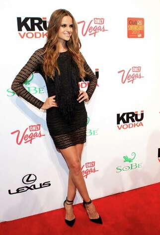 SI swimsuit model Izabel Goulart arrives at Club SI Swimsuit hosted by the Pure Nightclub at Caesars Palace at the Pure Nightclub at Caesars Palace on February 16, 2012 in Las Vegas, Nevada. Photo: Jacob Andrzejczak, Getty Images / 2010 Getty Images