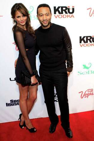 SI swimsuit model Chrissy Teigen and musician John Legend arrive at Club SI Swimsuit hosted by the Pure Nightclub at Caesars Palace at the Pure Nightclub at Caesars Palace on February 16, 2012 in Las Vegas, Nevada. Photo: Jacob Andrzejczak, Getty Images / 2010 Getty Images
