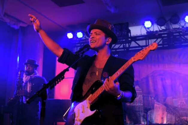 Singer Bruno Mars performs onstage at Club SI Swimsuit hosted by the Pure Nightclub at Caesars Palace at the Pure Nightclub at Caesars Palace on February 16, 2012 in Las Vegas, Nevada. Photo: Michael Loccisano, Getty Images / 2010 Getty Images