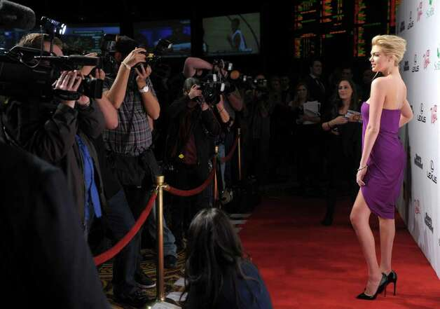 Sports Illustrated Swimsuit Issue cover model Kate Upton arrives at Club SI Swimsuit hosted by the Pure Nightclub at Caesars Palace at the Pure Nightclub at Caesars Palace on February 16, 2012 in Las Vegas, Nevada. Photo: Michael Loccisano, Getty Images / 2010 Getty Images