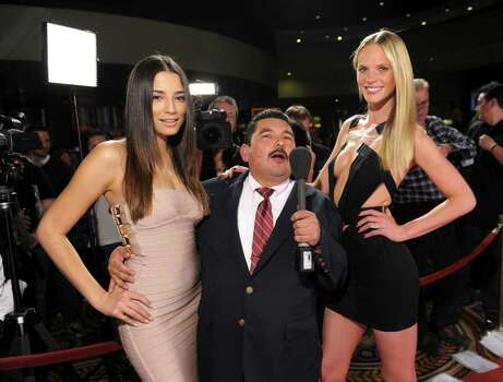 SI swimsuit models Jessica Gomes and Anne V with Guillermo Rodriguez (C) arrive at Club SI Swimsuit hosted by the Pure Nightclub at Caesars Palace at the Pure Nightclub at Caesars Palace on February 16, 2012 in Las Vegas, Nevada. Photo: Michael Loccisano, Getty Images / 2010 Getty Images