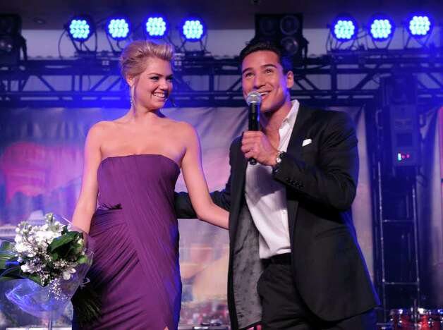 Sports Illustrated Swimsuit Issue cover model Kate Upton and TV personality Mario Lopez speak onstage at Club SI Swimsuit hosted by the Pure Nightclub at Caesars Palace at the Pure Nightclub at Caesars Palace on February 16, 2012 in Las Vegas, Nevada. Photo: Michael Loccisano, Getty Images / 2010 Getty Images