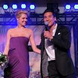 Sports Illustrated Swimsuit Issue cover model Kate Upton and TV personality Mario Lopez speak onstage at Club SI Swimsuit hosted by the Pure Nightclub at Caesars Palace at the Pure Nightclub at Caesars Palace on February 16, 2012 in Las Vegas, Nevada.