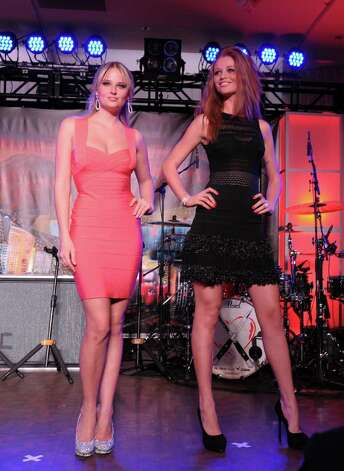 SI swimsuit models Genevieve Morton and Cintia Dicker onstage at Club SI Swimsuit hosted by the Pure Nightclub at Caesars Palace at the Pure Nightclub at Caesars Palace on February 16, 2012 in Las Vegas, Nevada. Photo: Michael Loccisano, Getty Images / 2010 Getty Images