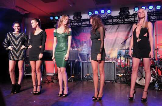 (L-R) SI swimsuit models Alyssa Miller, Nina Agdal, Julie Henderson, Chrissy Teigen and Anne V onstage at Club SI Swimsuit hosted by the Pure Nightclub at Caesars Palace at the Pure Nightclub at Caesars Palace on February 16, 2012 in Las Vegas, Nevada. Photo: Michael Loccisano, Getty Images / 2010 Getty Images