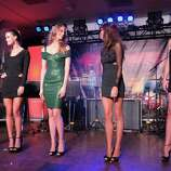 (L-R) SI swimsuit models Alyssa Miller, Nina Agdal, Julie Henderson, Chrissy Teigen and Anne V onstage at Club SI Swimsuit hosted by the Pure Nightclub at Caesars Palace at the Pure Nightclub at Caesars Palace on February 16, 2012 in Las Vegas, Nevada.